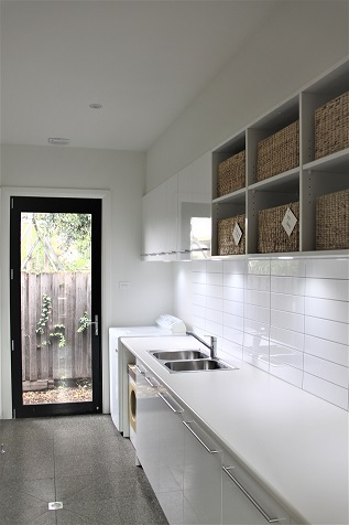 Laundry cupboards with overhead cupboard storage and benchtop