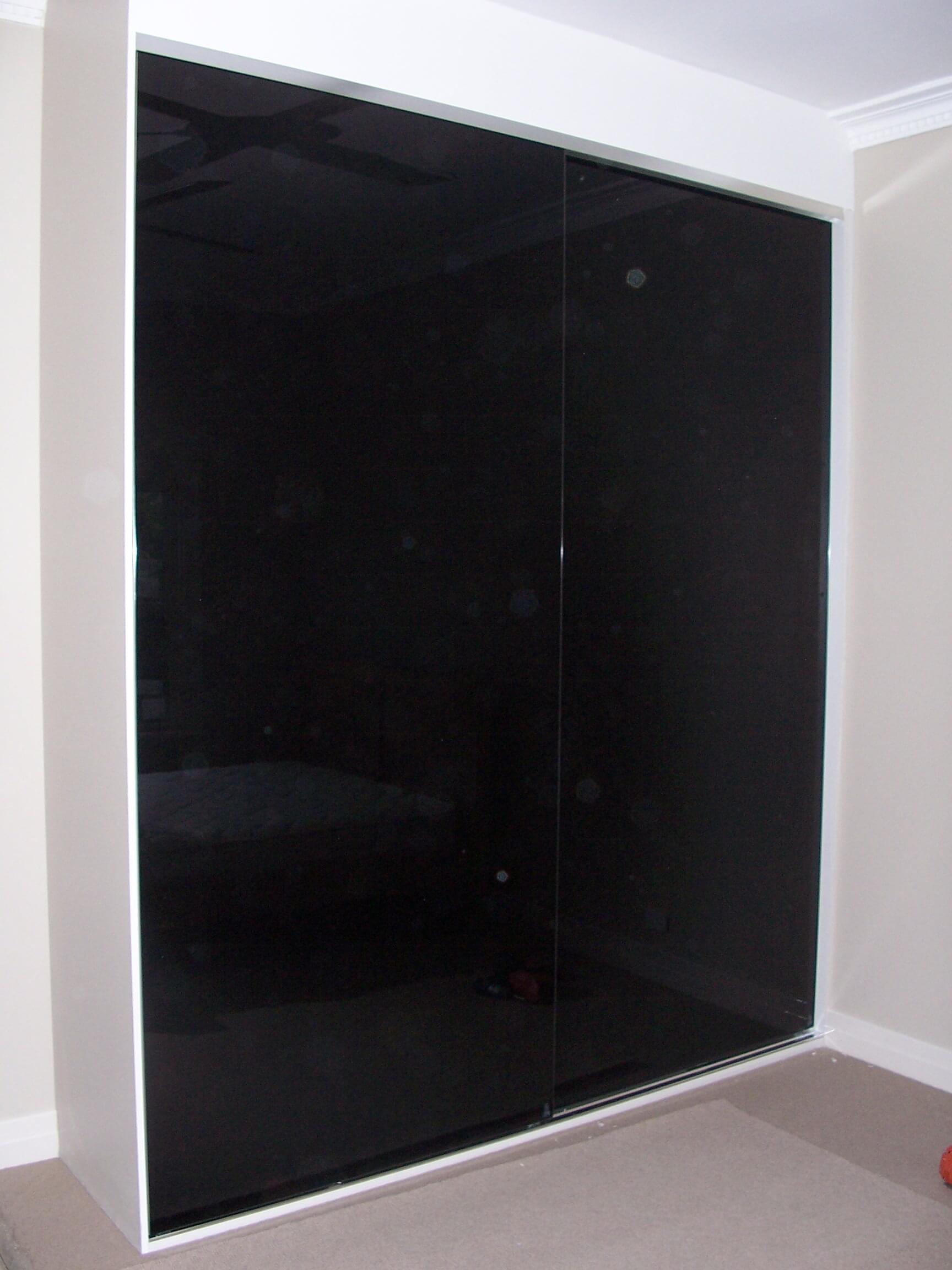 Black glass sliding door wardrobe
