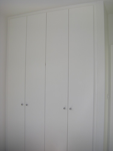 Hinged white melamine doors