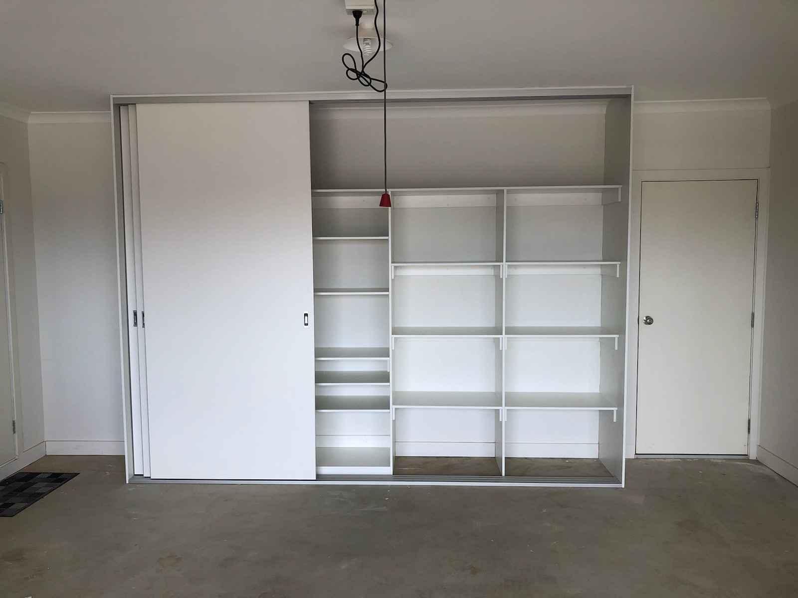 White melamine built in wardrobe with sliding doors