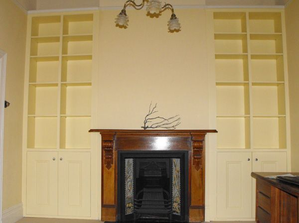 Custom Built Cabinets around Fire place