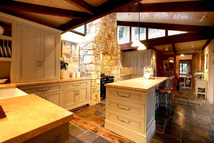 Traditional kitchen with stone benches