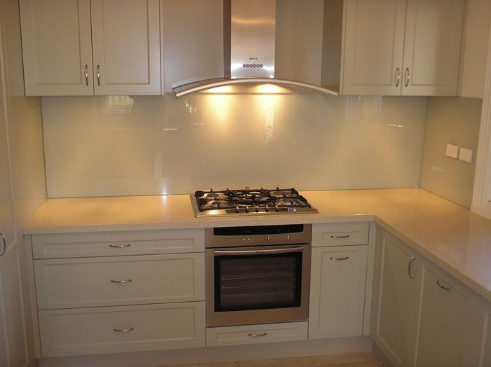 White vinyl wrap kitchen with white glass splashback