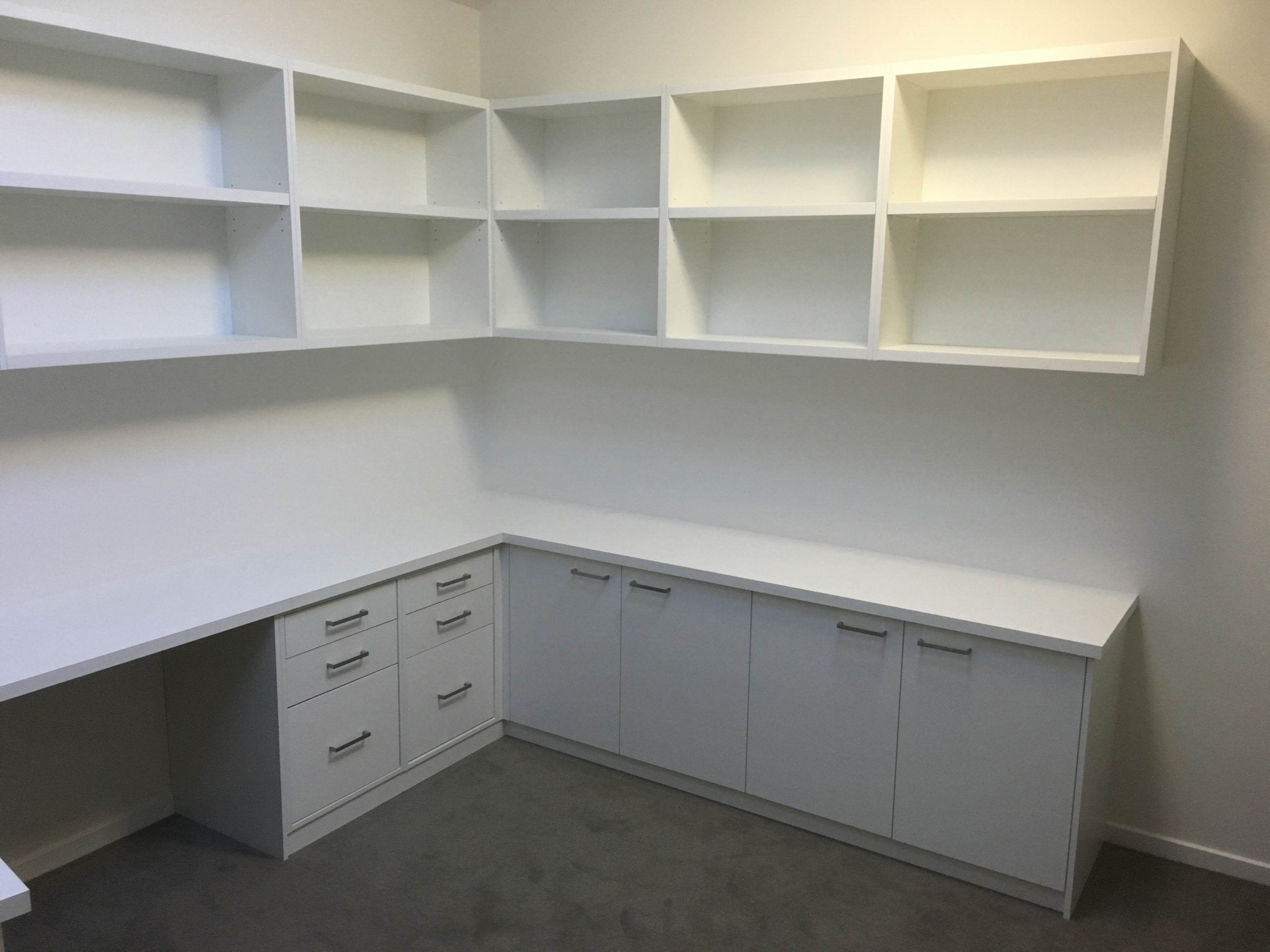 custom made desk in white melamine with cupboards and drawers