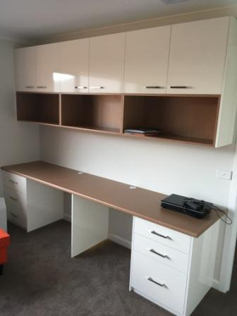 custom made desk with cupboards and shelves