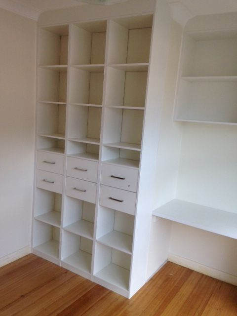 shelving and drawers with a custom made desk