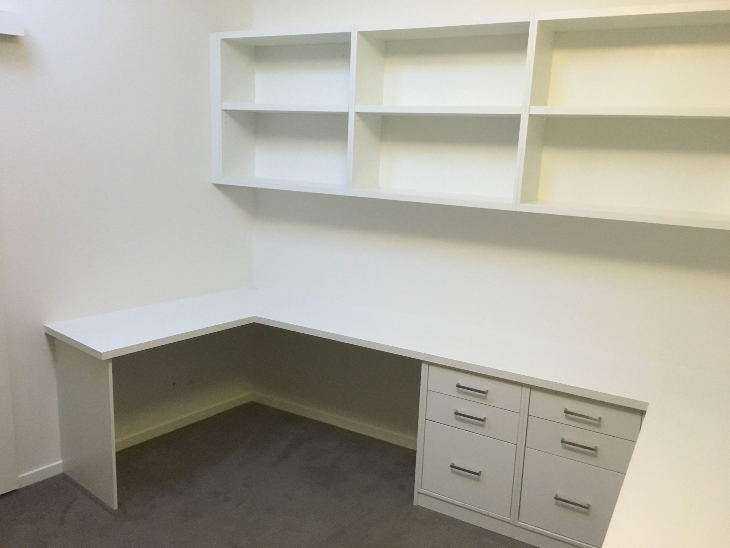 study area with desk, drawers and shelves