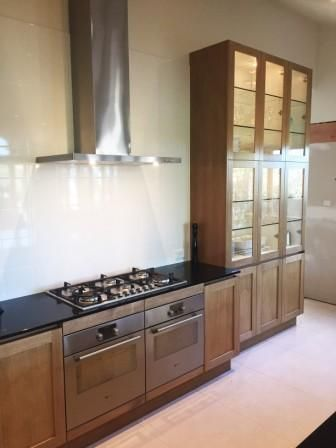timber veneer kitchen with glass doors
